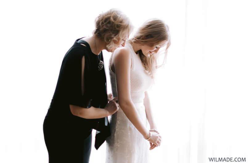 Elopement Las Vegas - crochet wedding dress - Mom and I putting on the dress