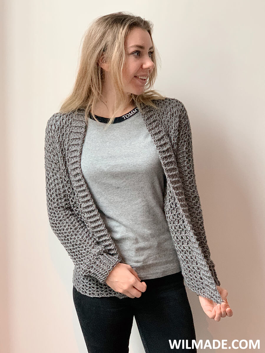 Touch of Merino Cardigan which is an easy and simple crochet cardigan pattern modeled by Karla in size S