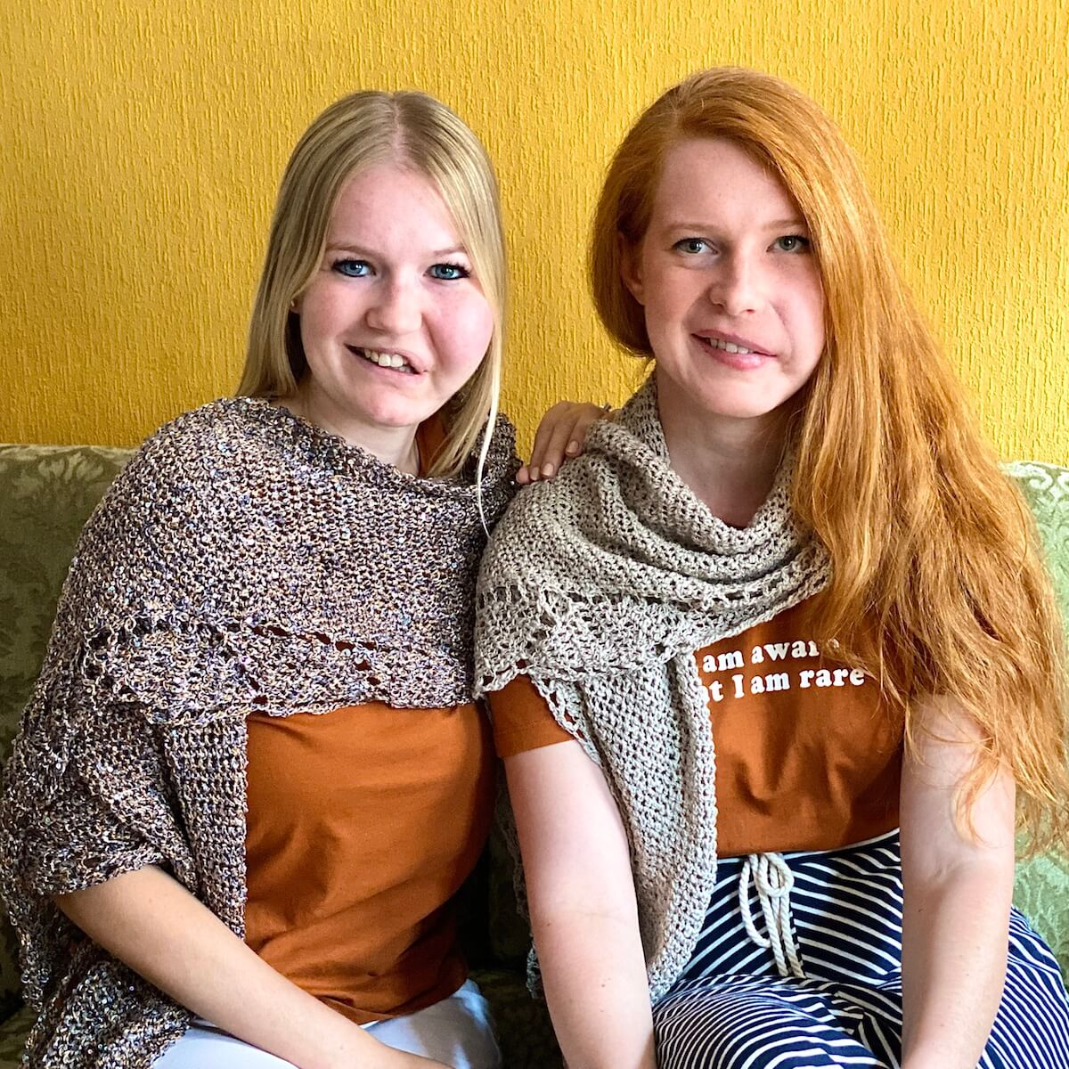 Wilma and Virginia wearing the Vibrant Virginia Shawl - facial infiltrating lipomatosis