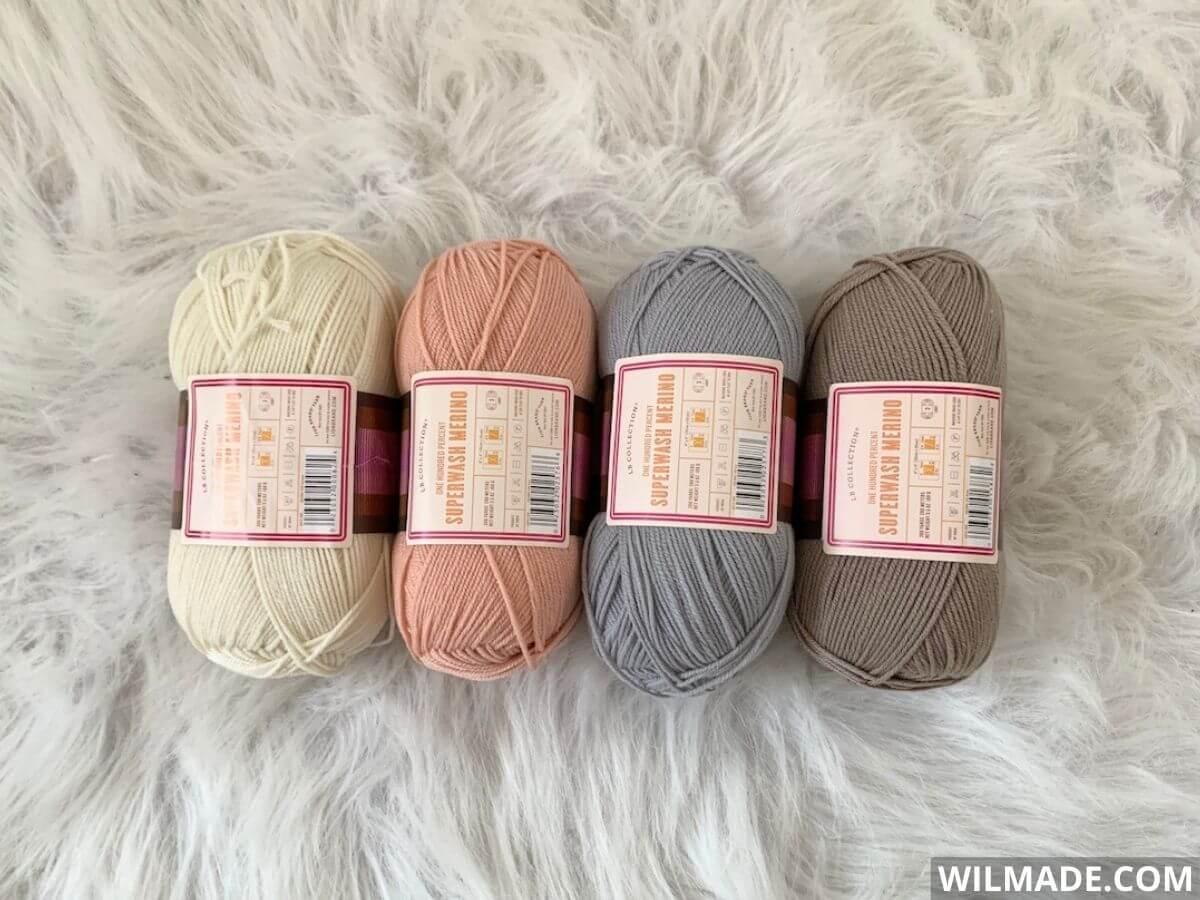 Lionbrand Superwash Merino yarn - off white, pink, grey, brown camel